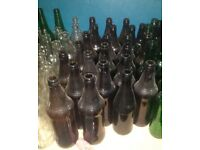 Home Brew fermenting barrel and bottle with around 40 beer bottles