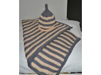 Hand knitted baby buggy blanket and matching beanie hat set in striking two-colour way stripes