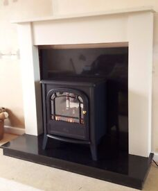 Full fireplace set up with Dimplex electric logburner effect stove, beech mantelpiece and granite