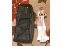 A used sarangi with bow and carry bag for £ 150.