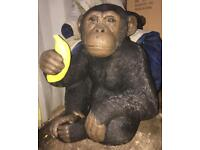 Large very heavy stone monkey with banana