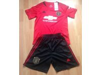 Brand new Manchester United top and shorts