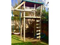 Wooden climbing frame with swing and wooden ladder made of treated timber and galvanised steel bars