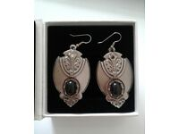 Silver metal antique style earrings with black stone