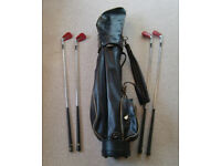 Four John Letters Irons (3, 5, 7, and 9) and a golf club bag