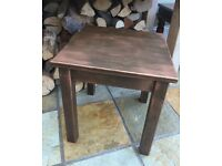 Brushed copper side table