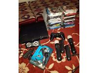 Sony PlayStation 3 Slim 320 GB Black Console with move, camera and 28 games