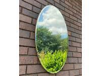 Large, oval, vintage mirror