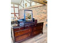 Stag minstrel 8 drawer chest with glass top and mirror