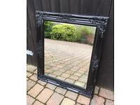 Large ornate black mirror