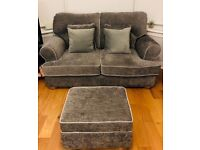 Two seater sofa and footstool with storage.