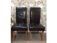 Four Leather covered Dining Chairs