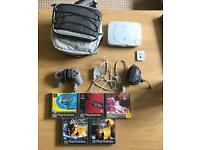 PSone console with 5 games memory card and bag