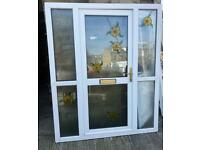 White Upvc door with 2 floral panels also with matching side pieces USED