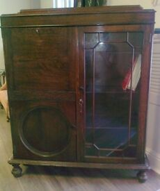 Handsome glass-fronted bookcase/display cabinet, with drop-down desk