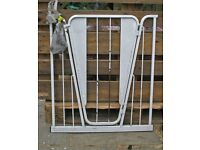 A sturdy stair gate that fits between wall and stair newell.