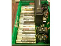 Xbox 360 with controllers and 34 games