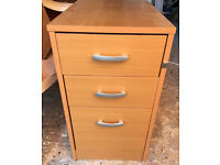 Executive office corner desk, set of matching drawers, and office swivel chair