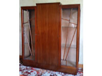 Dark wood china cabinet from around the 1950s