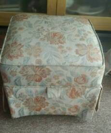 Tapestry storage footstool.
