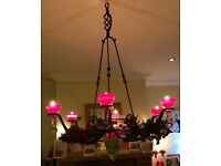 Iron chandalier , 6 glass candle holders and 1 large central glass vessel
