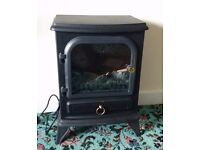 "Electric Stove "" Manor Zenith"" . Hardly used. Slight scratch marks at the top. Works perfectly."