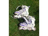 Girls roller blades and pads