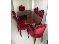 Mahogany Dining Table and Six Chairs (2 Carvers)
