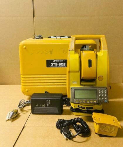 TOPCON GTS 603 TOTAL STATION WITH CASE, CHARGER, COMM CABLE, SUN SHADE, BATTERY