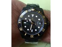 New black and gold rolex submariner watch