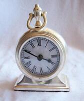 Horloge argentée