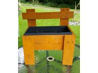 Rustic wooden chair planter with removable tub
