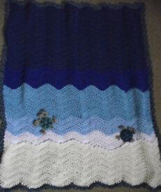 Handmade crochet baby sea turtles blanket/throw.