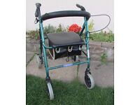 Good condition rollator 4 wheel walking aid with seat back rest & under seat bag foldable