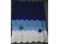 Handmade crochet baby sea turtles blanket/throw.