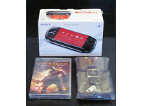 Brand new, boxed, Sony PSP 3003 PB Piano Black Console, mains charger, carry case and one game