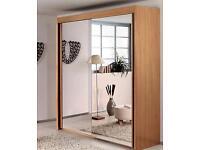 Large sliding mirror door wardrobe.