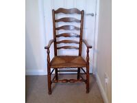 Antique High ladder back rush seated arm chair good condition