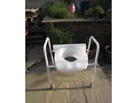 Uplift Commode/Disability raised toilet seat with adjustable frame - Pre-owned, never used