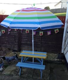 Kids garden wooden table and parasol