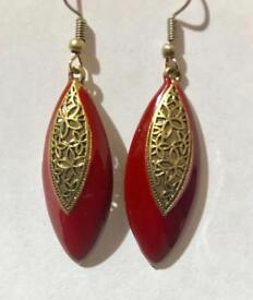Beautiful red and gold earrings.