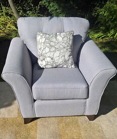 A stunning New Light Grey Fabric Material Arm Chair