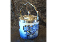 ironstone biscuit barrel with a white metal handle, rim and lid.