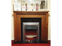 Electric fireplace with marble hearth, wood surround and large mirror