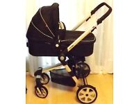 kids r us ,pram ,in black with adjustable handle bar and front swivel wheels ,and a raincover