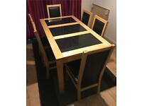 Solid wood dining table and 6 leather padded chairs delivery available