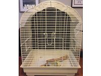 Bird cage. Good condition with wooden poles, feeding tray and some toys