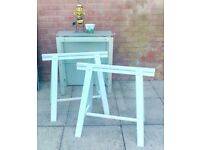 TWO WOODEN TRESTLES & METAL UNIT with GLASS SHELVES