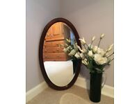 Antique oval mirror with inlaid marquetry and bevel edge glass