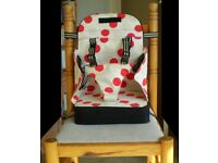 Adjustable travel toddler seat, fits quickly to most dining chairs, folds to compact size